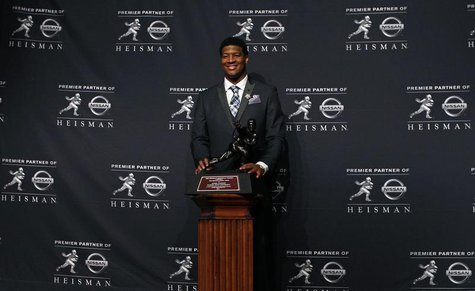 Dec 14, 2013; New York, NY, USA; Florida State Seminoles quarterback Jameis Winston poses for a photo after being awarded the 2013 Heisman T