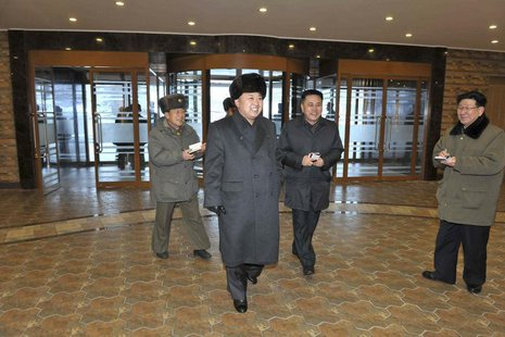 North Korean leader Kim Jong Un (C) visits the Masik-Ryong Ski Resort, which is near completion, near Wonsan in this undated photo released