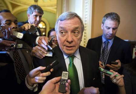 Senator Dick Durbin (D-IL) arrives for the Democrat policy luncheon on Capitol Hill in Washington October 15, 2013. REUTERS/Joshua Roberts