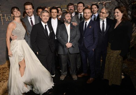 "Cast and crew members pose for photographers at the premiere of the film ""The Hobbit: The Desolation of Smaug"" in Los Angeles December 2, 20"