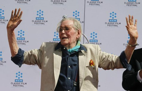 Irish-born actor Peter O'Toole displays his cement-covered hands after placing his handprints in cement during hand and footprint ceremonies