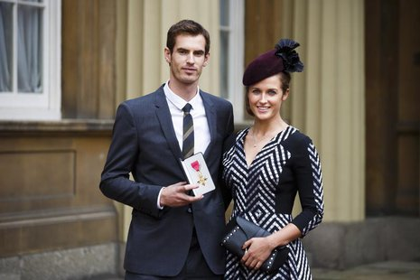 Wimbledon champion Andy Murray poses with his girlfriend Kim Sears, and his Officer of the Most Excellent Order of the British Empire (OBE)