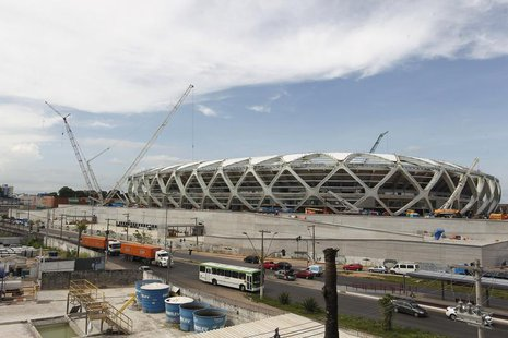 The Arena Amazonia stadium is under construction to host several 2014 World Cup soccer games, in Manaus December 14, 2013. REUTERS/Bruno Kel