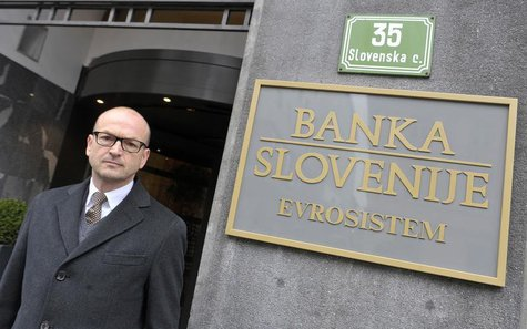 Bostjan Jazbec, Slovenia's central bank governor, poses before an interview in front of the office building of Slovenia's national bank in L