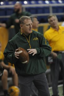 Chris Klieman warming up with NDSU players recently.