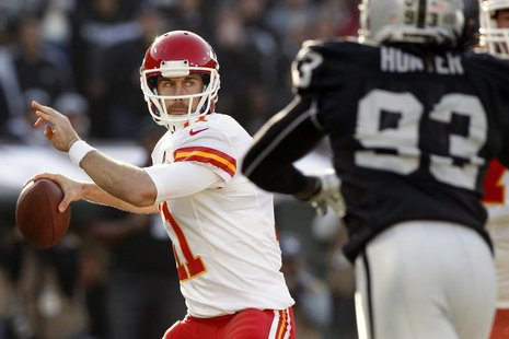 Dec 15, 2013; Oakland, CA, USA; Kansas City Chiefs quarterback Alex Smith (11) prepares to throw a pass against the Oakland Raiders in the s