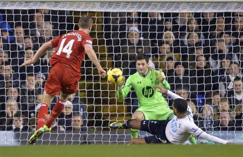 Liverpool's Jordan Henderson (L) scores a goal against Tottenham Hotspur during their English Premier League soccer match at White Hart Lane