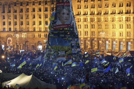 Pro-European integration protesters gather under an image of jailed opposition leader Yulia Tymoshenko in Independence Square in Kiev Decemb