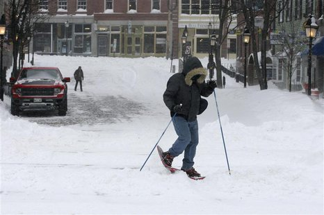 Jason Gallant snowshoes to work after a snowstorm in Portland, Maine December 15, 2013. REUTERS/Joel Page