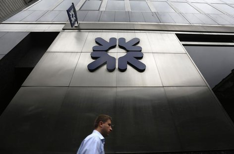 A man passes a branch of Royal Bank of Scotland (RBS) in London November 1, 2013. REUTERS/Luke MacGregor