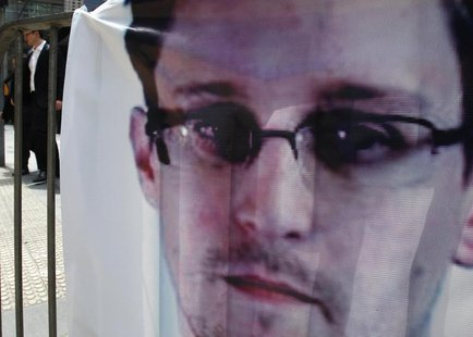 A banner supporting Edward Snowden, a former contractor at the National Security Agency (NSA), is displayed at Hong Kong's financial Central