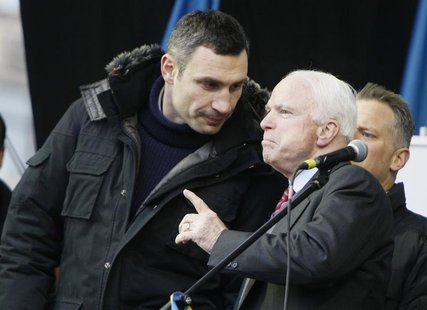 U.S. Senator John McCain (R) speaks with Ukrainian opposition leader Vitaly Klitschko (L) during a mass rally by pro-European integration pr