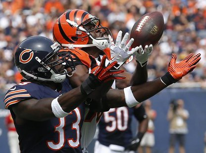 Cincinnati Bengals' Andrew Hawkins (R) makes a catch against Chicago Bears' Charles Tillman during the first quarter of their NFL football g