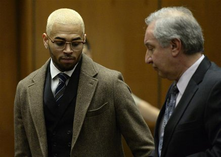 Singer Chris Brown (L) and his attorney Mark Geragos appear in court during a probation violation hearing in which his probation was revoked