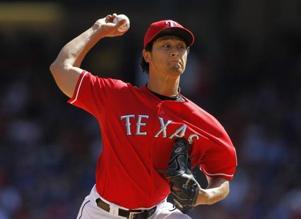 Texas Rangers starting pitcher Yu Darvish pitches against the Los Angeles Angels in the fourth inning of their MLB American League baseball
