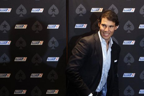 Spanish tennis player Rafael Nadal arrives for a news conference before a celebrity poker tournament, the European Poker Tour Charity Challe