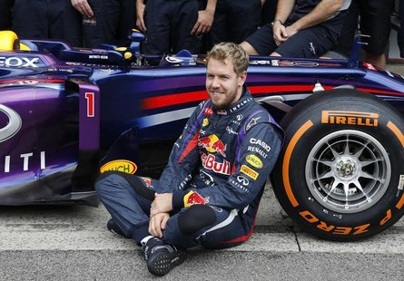 Red Bull Formula One driver Sebastian Vettel of Germany is pictured as he poses for the media with the Red Bull team before the Brazilian F1