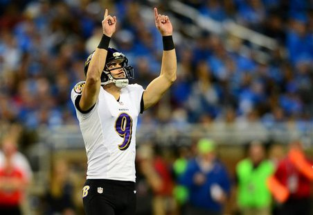 Dec 16, 2013; Detroit, MI, USA; Baltimore Ravens kicker Justin Tucker (9) celebrates after kicking a field goal during the third quarter aga