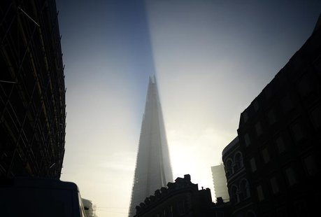 The early morning sun hits The Shard building as fog clears over London, September 5 , 2013. REUTERS/Dylan Martinez