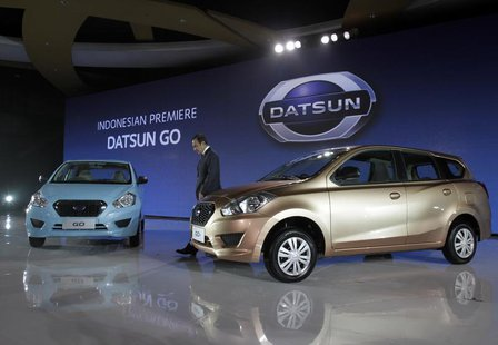 Datsun Chief Executive Carlos Ghosn walks during launch Datsun GO in Jakarta, September 17, 2013. REUTERS/Supri
