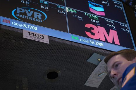 Specialist trader Peter Elkins works at the post that trades Chevron, PVR Partners and 3M on the floor of the New York Stock Exchange, Octob