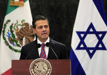 Mexico's President Enrique Pena Nieto gives a speech next to Israel's President Shimon Peres (not pictured) during a news conference after a