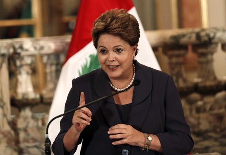 Brazil's President Dilma Rousseff speaks to the press at the government palace in Lima, November 11, 2013. Rousseff is on a one-day official