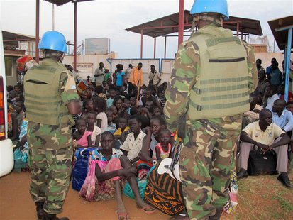 Civilians take shelter at the United Nations Mission in the Republic of South Sudan (UNMISS) compound on the outskirts of the capital Juba i