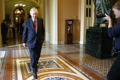 U.S. Senate Minority Leader Mitch McConnell (R-KY) returns to his office, declining to speak with reporters after a Senate Republican caucus