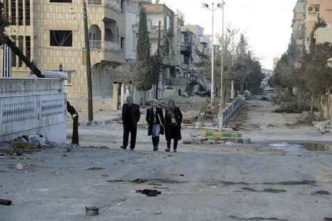 Residents walk at Nabek town north of Damascus in the Qalamoun mountains, after forces loyal to Syria's President Bashar al-Assad took contr