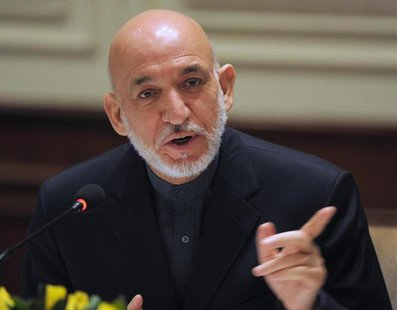 Afghanistan's President Hamid Karzai addresses media representatives during a press interaction in New Delhi December 14, 2013. Karzai is on