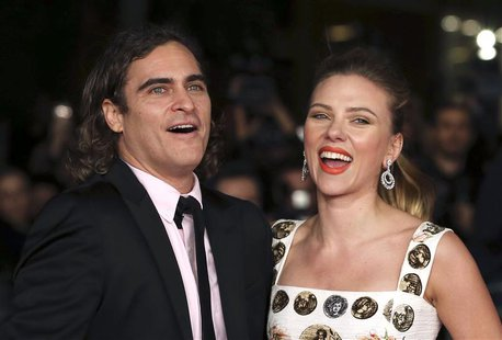 "Cast members Joaquin Phoenix (L) and Scarlett Johansson (R) arrive for a red carpet event for the movie ""Her"" at the Rome Film Festival, in"