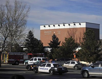 Police and rescue workers arrive at Arapahoe High School, after a student opened fire in the school in Centennial, Colorado December 13, 201