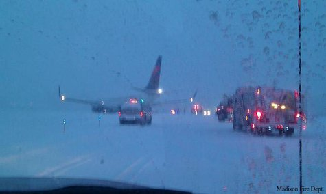 A plane off the runway at Dane County Regional Airport in Madison, Monday, Dec. 16, 2013. (Photo from: Madison Fire Department/FOX 11)