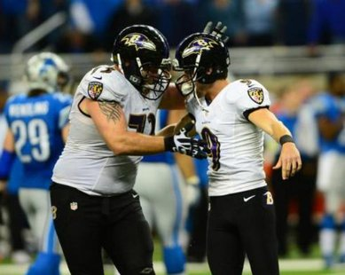 Baltimore Ravens kicker Justin Tucker (9) celebrates with guard Marshal Yanda (73) after kicking a 61 yard field goal during the fourth quarter against the Detroit Lions at Ford Field. Baltimore Ravens defeated the Detroit Lions 18-16. Mandatory Credit: Andrew Weber-USA TODAY Sports