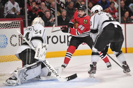 Dec 15, 2013; Chicago, IL, USA; Chicago Blackhawks right wing Patrick Kane (88) shoots the puck against Los Angeles Kings goalie Ben Scriven