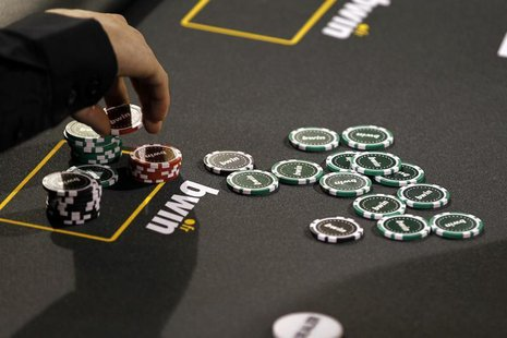 Betting company Bwin Interactive Entertainment AG logo is pictured with chips on a poker table during an event in Paris, December 3, 2010. R