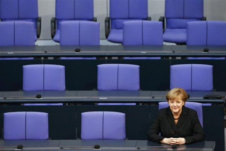 German Chancellor Angela Merkel sits in the Bundestag, lower house of parliament, after she was sworn-in, in Berlin December 17, 2013. REUTE
