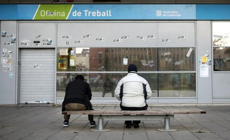 People wait for the opening of an employment office in Badalona, near Barcelona, December 3, 2013. REUTERS/Albert Gea