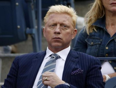 Tennis great Boris Becker of Germany watches the match between Richard Gasquet of France and Rafael Nadal of Spain during the men's semi-fin