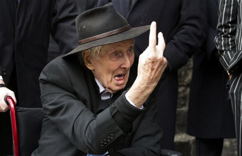 File photograph shows Great Train Robber Ronnie Biggs gesturing as he arrives for the funeral of Bruce Reynolds, at the church of St Barthol