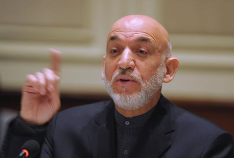 Afghanistan's President Hamid Karzai gestures as he addresses media representatives during a press interaction in New Delhi December 14, 201
