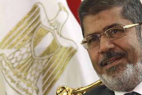 Egypt's President Mohamed Mursi attends a meeting with Palestinian President Mahmoud Abbas to discuss about the latest developments in the s