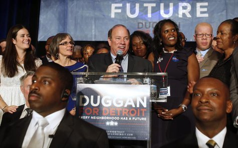 Detroit mayoral candidate Mike Duggan (C) addresses his supporters after being declared the projected winner on election day in Detroit, Mic