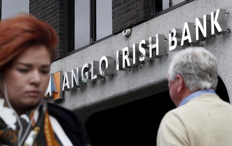 Pedestrians are seen walking past a branch of the Anglo Irish Bank in Dublin in this September 30, 2010 file photograph. REUTERS/Cathal McNa