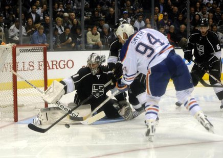 Dec 17, 2013; Los Angeles, CA, USA; Los Angeles Kings goalie Martin Jones (31) blocks a shot by Edmonton Oilers left wing Ryan Smyth (94) du
