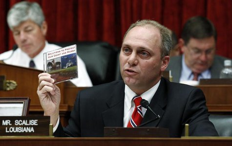 "U.S. Representative Steve Scalise (R-LA) holds up a CD entitled ""Solutions to Protect our Coast and Marsh"" that he presented to BP CEO Tony"