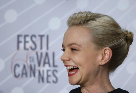 Cast member Carey Mulligan reacts as she attends a news confernce for the film 'Inside Llewyn Davis' during the 66th Cannes Film Festival in
