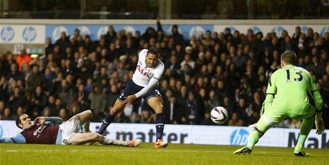 Nacer Chadli (C) of Tottenham Hotspur has his shot saved by Adrian of West Ham United during their English League Cup quarter-final soccer m