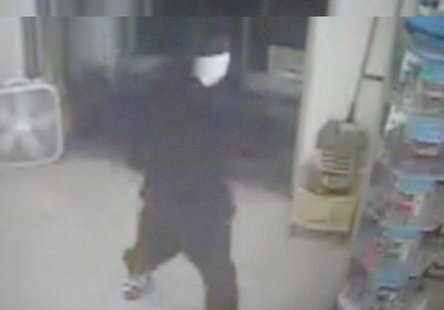 This is the suspect they identify as the one holding the gun, although it is not visible in this picture.